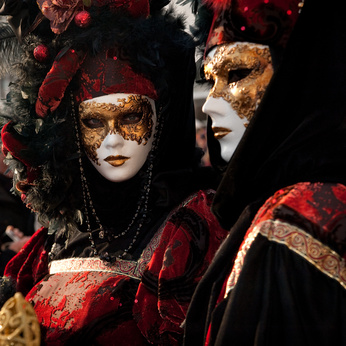carnivale goers in costume and masks - photo courtesy of www.italialiving.com